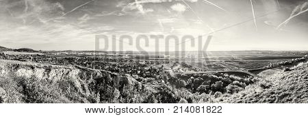 Drazovce village and industrial park Nitra - North in sunset Slovak republic. Autumn panoramic scene. Landscape in middle Europe. Black and white photo.