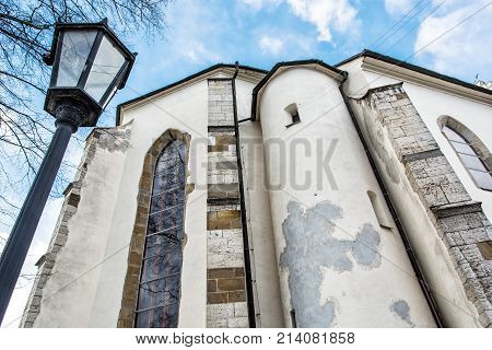 Basilica of the Holy Cross with exterior lantern in Kezmarok city Slovak republic. Religious architecture. Travel destination. Closeup photo.