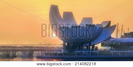 SINGAPORE CITY, SINGAPORE: APRIL 17, 2017: Sunrise at business bay and Singapore city skyline with Singapore museum