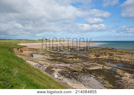 Seahouses beach Northumberland coast north east England UK with view to Bamburgh Castle tourist attraction