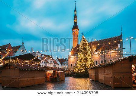 Tallinn, Estonia. Traditional Christmas Market On Town Hall Square - Raekoja Plats. Christmas Tree And Trading Houses. Famous Landmark At Xmas Time