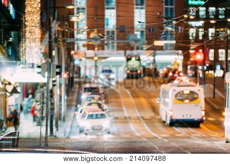 Natural Defocused Blue Bokeh Boke Background Of Night Traffic In Street Of  European City. Design Backdrop. Night Illumination
