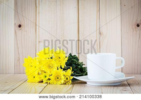 Yellow Chrysanthemum Flowers With Coffee Cup On Wooden Background