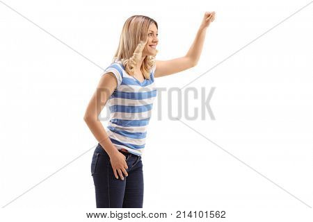 Young woman knocking on a door isolated on white background