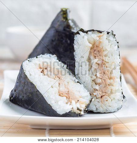 Korean triangle kimbap Samgak made with nori rice and tuna fish similar to Japanese rice ball onigiri square