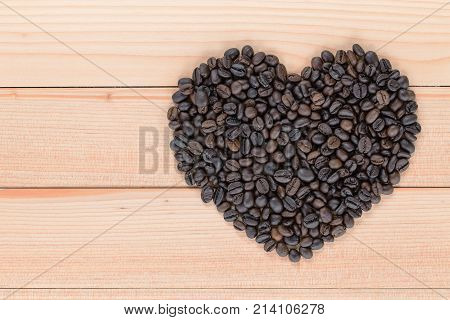 Heart Shaped Coffee Beans On A Wooden Background