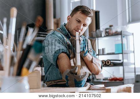 Craftsman Holding Wooden Board