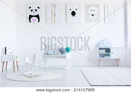 White Rocking Horse On Carpet