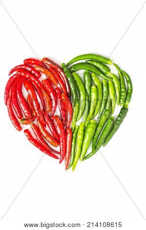 Peppers arranged in heart shape on white background
