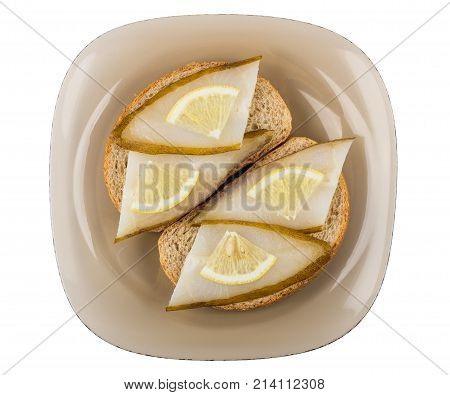 Sandwiches With Smoked Halibut And Lemon In Brown Plate