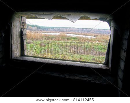 A window in the old building overlooking the swampy lake.