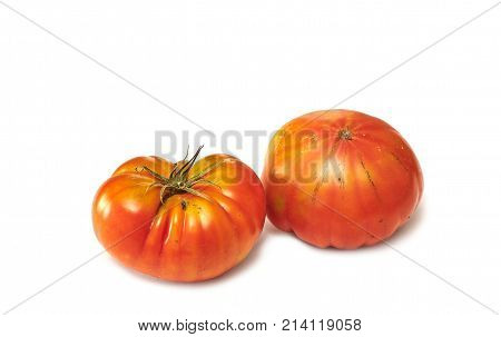 A pair of raf tomatoes isolated on white.