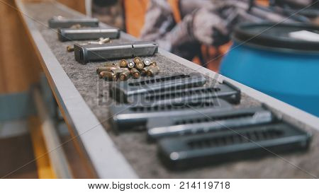 Pistol clips with bullets in shooting gallery, close up