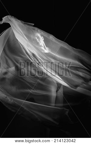 Russia, Moscow, October 1, 2017: Female Gymnast Posing On A Black Background And White Cloth. Art Ph