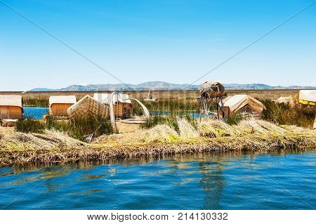 Titicaca lake Puno Peru - March 20 2017. Uros floating islands on Titicaca lake in Puno Peru South America