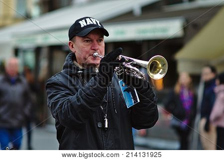 Prague Czech Republic - November 15 2017: Musikant playing trumpet on Old Town Square