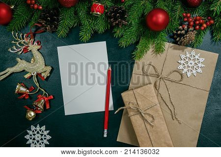 Christmas Background Or Xmas Card  With Decorations Fir, Gift Box And Ornamen. Space For Holiday Gre