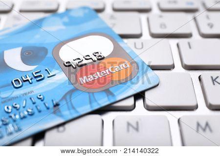 KIEV, UKRAINE - OCTOBER 2, 2017: Blue MasterCard credit card on keyboard
