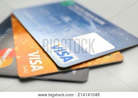 KIEV, UKRAINE - OCTOBER 2, 2017: Different Visa and MasterCard credit cards on light background
