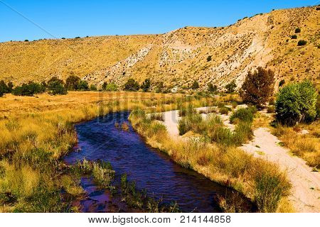 Deep Creek surrounded by an arid landscape taken at the Mojave Desert near Hesperia, CA poster