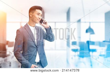 Asian Businessman On Phone In An Office