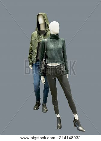 Full-length two mannequins male and female dressed in casual clothes isolated. No brand names or copyright objects.