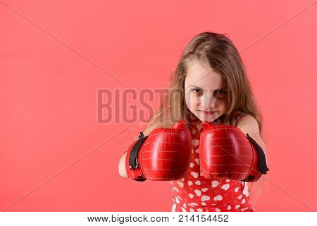Young Woman Posing In Boxing Gloves On Red Background