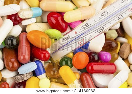 fever thermometer and tablets