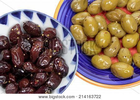 Close Up of Two Plates of Olives