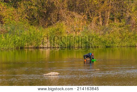 Man With Green Basket Fishing In Kumgang River
