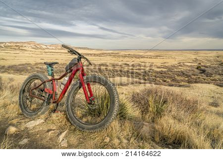 fat mountain bike on a trail in Soapstone Prairie Natural Area in northern Colorado, late fall scenery