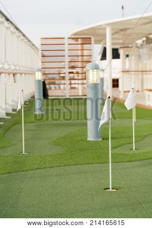 Artificial turf on mini golf or putting green on deck of cruise ship