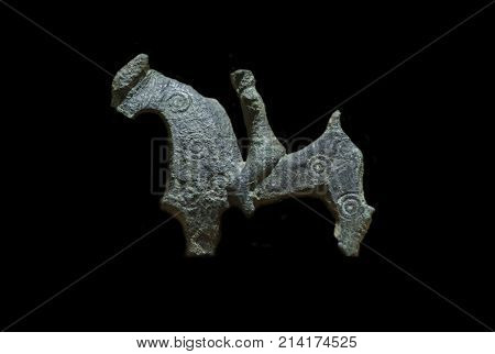 Caceres Spain - October 29 2017: Rider shaped bronze votive offering. Bronze fundido. Caceres Archaeological Museum