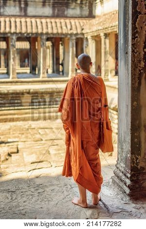 Buddhist Monk Exploring Courtyards Of Angkor Wat, Cambodia