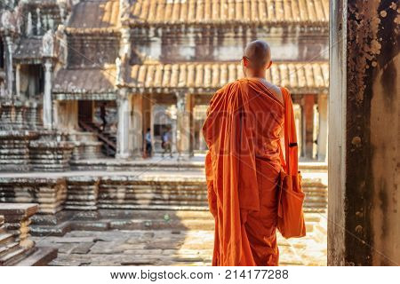 Buddhist Monk Looking At Courtyard Of Angkor Wat, Cambodia