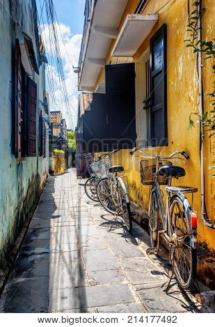 Bicycles Parked Near Yellow Wall, Hoi An (hoian), Vietnam