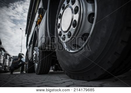 Maintaining Semi Truck Tires Concept Photo. Trucking Industry.
