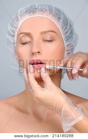 Beautiful Girl Receiving Filler Injection In Lips. Plastic Surgery.