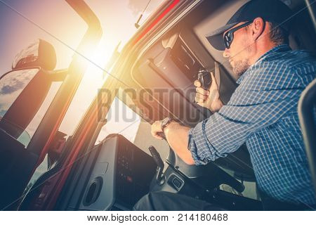 Trucker Preparing For Trip. Truck Driver Job. Caucasian Men Talking on CB Radio.