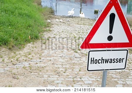 German general warning sign and additional sign with german text for flood