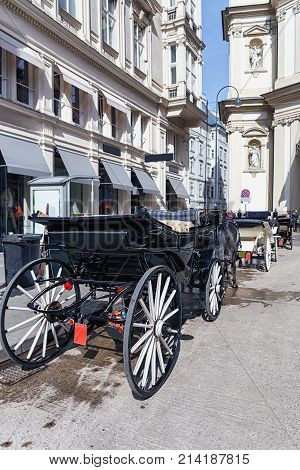 beautiful horse-drawn carriages on the streets of Vienna as background