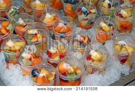 Fresh Fruit Salad With Pieces Of Fruit And Ice Cubes