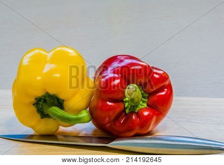 Red And Yellow Paprika On Wooden Cutting Board