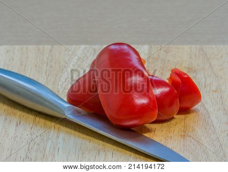 Slices Of Red Paprika On A Wooden Cutting Board