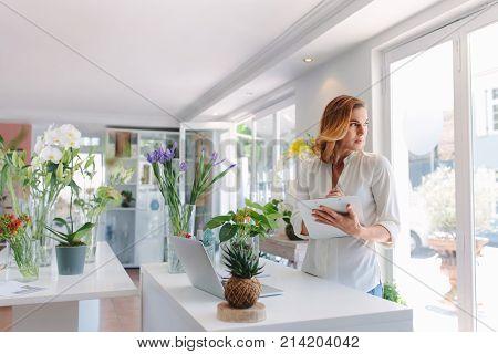 Woman Florist Working In Flower Shop