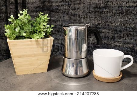 Cuisine and Food Two White Porcelain Cup and Coffee Pot with Artificial Plant on The Table Used for Preparing and Drinking Coffee in The Morning.