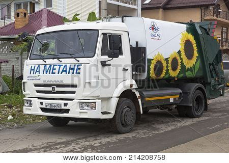 Lazarevskoe, Sochi, Krasnodar region, Russia - July 6 2014: Garbage truck CMZL-9G on based on KAMAZ chassis 4308 on methane