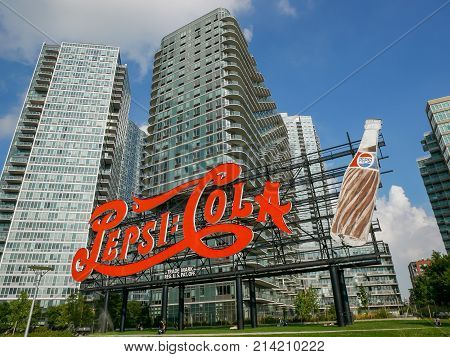 NEW YORK - SEP 2017: Landmark of classic Pepsi-Cola Sign and modern apartment buildings in Quinees New York City