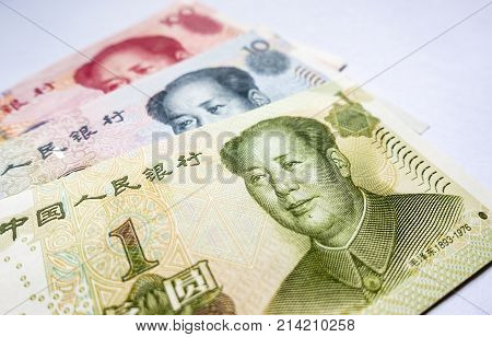 Closeup of China's one hundred, ten and one dollar bill denominations. Currency notes in high-resolution on a plain background. Also known as Renminbi (RMB) or Yuan.