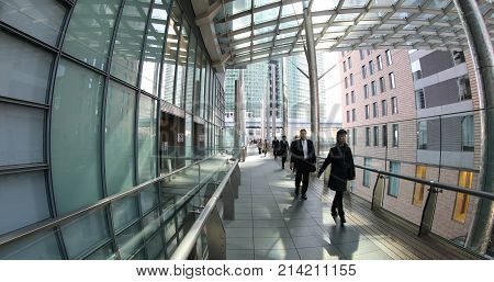 Tokyo, Japan - April 20, 2017: Japanese white-collar workers walking in Shiodome City Center area.Business people commuter in Shinbashi Financial District. Wide angle view. Corporate cityscape concept